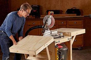 man using miter saw
