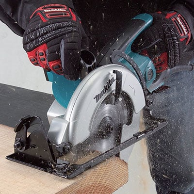 Makita 5477NB cutting wood