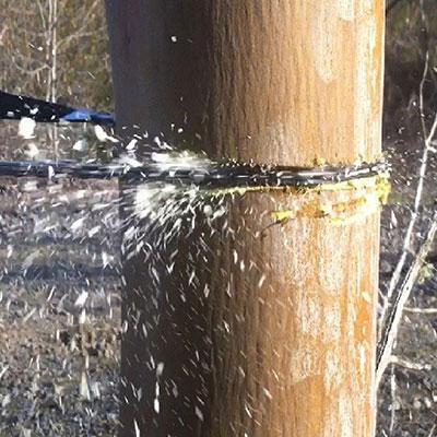 Sportsman Pocket Chainsaw Cutting Wood