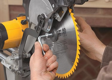 How to change a dewalt miter saw blade tool nerds change a dewalt miter saw blade greentooth Choice Image
