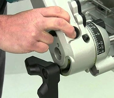 unlocking the base of a miter saw