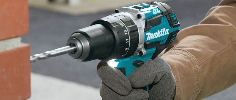 Man Drilling Bricks With Makita XT269M