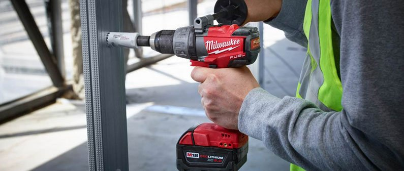 Man Drilling Metal with Milwaukee
