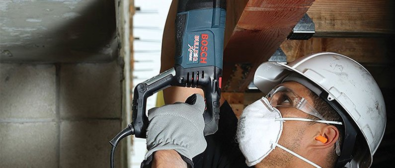 A Man Wearing Safety Goggles While Using Bosch 11255VSR