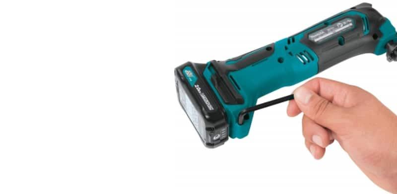 A hand holding Makita MT01R1 Tool