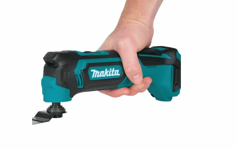Hand holding strongly Makita Multi Tool