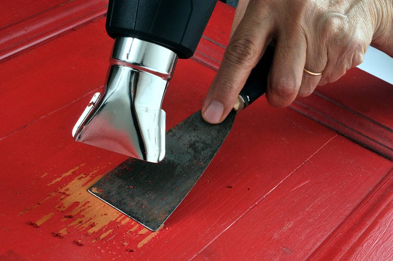 Stripping paint with heat gun