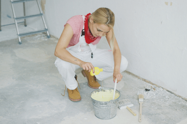 Thinning paint for use in a paint sprayer